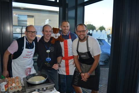 Managers at Coastline fundraising with a fry-up