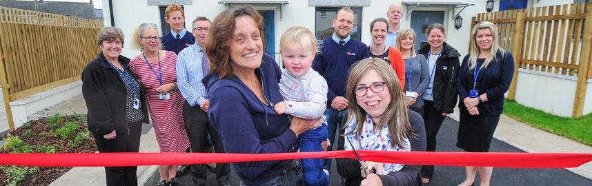 Cutting the ribbon at a new housing development