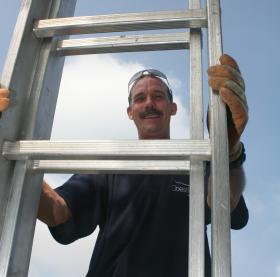 Workman with ladder